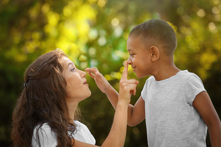 mother and son touching each others noses