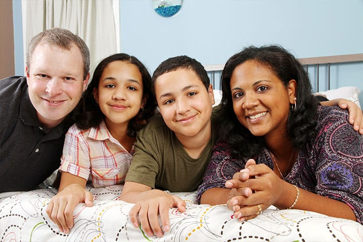 a portrait of a happy mixed race family